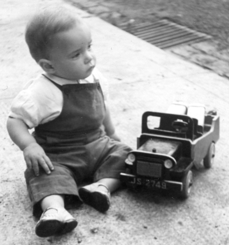 toddler with model jeep